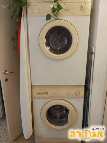 מכונת כביסה ומיבש עובדים